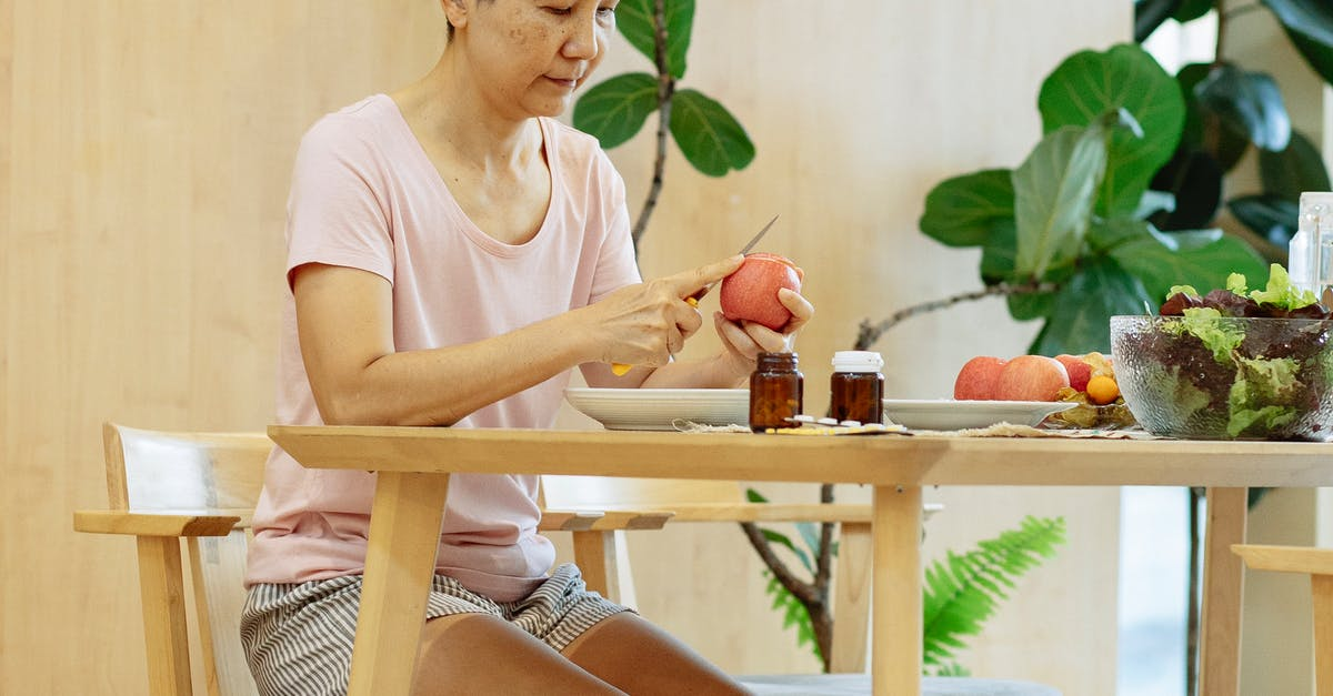 A person sitting on top of a wooden table
